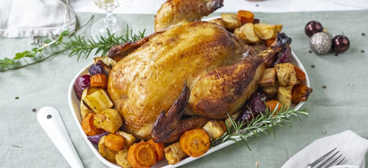 Hele kip uit de oven met wintergroenten